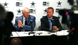 Dallas Cowboys owner and general manager Jerry Jones, left, and head coach Jason Garrett speak at a press conference at Valley Ranch, Thursday May 8, 2014, in Irving, Texas. The team selected Notre Dame offensive lineman Zack Martin with the16th overall pick in the first round of the NFL draft.(AP Photo/The Fort Worth Star-Telegram, Ron Jenkins)    MAGS OUT; (FORT WORTH WEEKLY, 360 WEST); INTERNET OUT