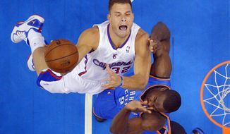 Los Angeles Clippers forward Blake Griffin, left, puts up a shot as Oklahoma City Thunder forward Serge Ibaka, of Congo, defends in the first half of Game 3 of the Western Conference semifinal NBA basketball playoff series, Friday, May 9, 2014, in Los Angeles. (AP Photo/Mark J. Terrill)