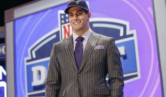Eastern Illinois quarterback Jimmy Garoppolo poses for photos after being selected as the 62nd pick by the New England Patriots in the second round of the 2014 NFL Draft, Friday, May 9, 2014, in New York. (AP Photo/Jason DeCrow)