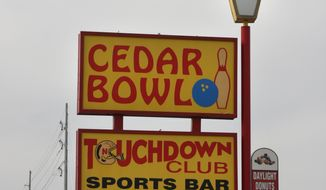 FOR RELEASE SATURDAY, MAY 10, 2014, AT 12:01 A.M. CDT - This Monday May 5, 2014 photo shows the signage for the Cedar Bowl and Touchdown Club in North Platte, Neb. The landmark bowling alley closed its doors on Monday. (AP Photo/The Telegraph, Diane Wetzel)