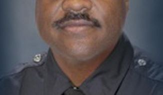 This undated image provided by the Los Angeles Police Department shows detective Ernest L. Allen Sr., who died May 9, 2014, when a cement truck smashed into his pickup truck in Beverly Hills, Calif. The fatal accident occurred Friday on the same steep road where another truck accident killed an LAPD policeman two months ago. (AP Photo/Los Angeles Police Department)