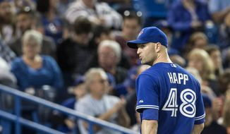 Toronto Blue Jays pitcher J.A. Happ walks off the field after being pulled from the game during the third inning of a baseball game against the Los Angeles Angels in Toronto on Saturday, May 10, 2014. (AP Photo/The Canadian Press, Chris Young)