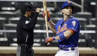 New York Mets' David Wright reacts after striking out during the eleventh inning of a baseball game against the Philadelphia Phillies, Friday, May 9, 2014, in New York. The Phillies game 3-2. (AP Photo/Frank Franklin II)
