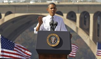 FILE - In this Nov. 2, 2011, file photo, President Barack Obama speaks in front of the Key Bridge in Washington.  White House official says the Obama administration will intensify its efforts to get Congress to pass legislation that pays for roads and bridge repair. (AP Photo/Pablo Martinez Monsivais, File)