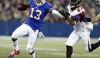 FILE - In this Dec. 1, 2013, file photo, Buffalo Bills wide receiver Stevie Johnson (13) pushes off Atlanta Falcons cornerback Robert McClain (27) during the first half of an NFL football game in Toronto.  The Bills traded Johnson to the San Francisco 49ers on Friday, May 9, 2014, in a deal made before the start of the second round of the NFL draft.  (AP Photo/Gary Wiepert, File)