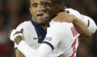PSG's Blaise Matuidi, right, reacts with PSG's Lucas after scoring the third goal during his French League one soccer match at the Lille Metropole stadium, in Villeneuve d'Ascq, northern France, Saturday, May 10, 2014. Paris Saint-Germain have  won their second straight French league title. (AP Photo/Michel Spingler)