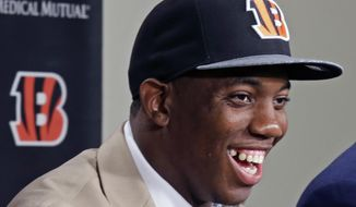 Cincinnati Bengals first round draft pick Darqueze Dennard, a cornerback out of Michigan State, answers questions at a news conference at the NFL football team's stadium, Saturday, May 10, 2014, in Cincinnati.  (AP Photo/Al Behrman)
