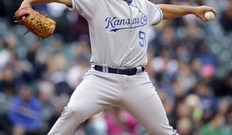 Kansas City Royals starting pitcher Jason Vargas throws against the Seattle Mariners in the second inning of a baseball game Friday, May 9, 2014, in Seattle. (AP Photo/Elaine Thompson)