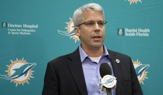 Miami Dolphins general manager Dennis Hickey introduces the team's first round draft pick Ja'Wuan James during an NFL football news conference Friday, May 9, 2014, in Davie, Fla. The Dolphins selected James, an offensive tackle from Tennessee, with the 19th overall pick in Thursday's draft. (AP Photo/J Pat Carter)