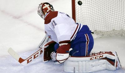 Montreal Canadiens goalie Carey Price (31) looks back as he is beat for a goal by Boston Bruins center Carl Soderberg during the first period of Game 5 in the second-round of the Stanley Cup hockey playoff series in Boston, Saturday, May 10, 2014. (AP Photo/Charles Krupa)
