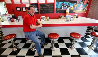 ADVANCE FOR RELEASE SATURDAY, MAY 10, 2014, AND THEREAFTER- In this May 2, 2014 photo, Pat Orr, owner of the Maid-Rite, sits for a photo in Cascade, Iowa.  Recent strange events at the restaurant have the owner and his employees spooked. (AP Photo/The Telegraph Herald, Dave Kettering)