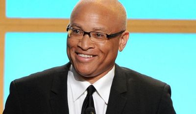 """** FILE ** In this Monday, June 10, 2013, photo, Larry Wilmore accepts the best talk show award for """"The Daily Show with Jon Stewart"""" at the Critics' Choice Television Awards in the Beverly Hilton Hotel in Beverly Hills, Calif. (Photo by Frank Micelotta/Invision/AP)"""