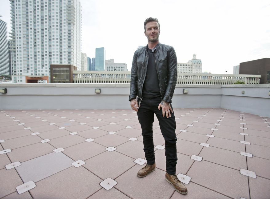 ** FILE ** In this March 24, 2014, file photo, former England soccer star David Beckham speaks during a news conference in Miami. (AP Photo/Wilfredo Lee, File)