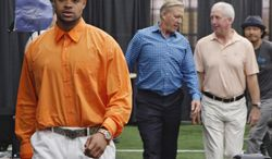 Denver Broncos second round draft pick Indiana wide receiver Cody Latimer, left,  leads the way to a news conference at the NFL football teams headquarters in Englewood, Colo., on Saturday, May 10, 2014.  He is followed by Broncos vice president John Elway, center, and head coach John Fox. (AP Photo/Ed Andrieski)