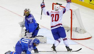Norway's Anders Bastiansen celebrates after scoring against Italy's Daniel Bellissimo, left, and Christian Borgatello (50) during the Group A preliminary round match at the Ice Hockey World Championship in Minsk, Belarus, Saturday, May 10, 2014. (AP Photo/Sergei Grits)