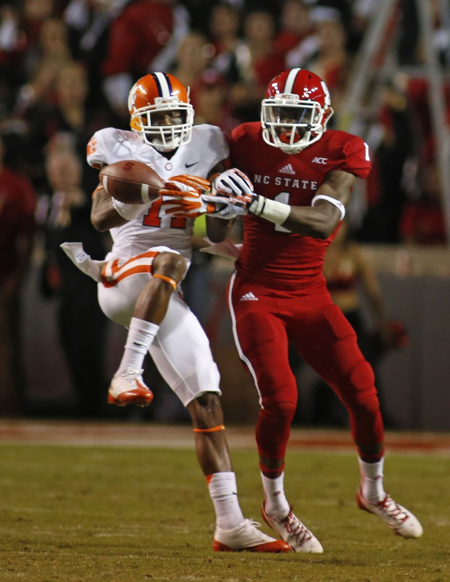Clemson's Bashaud Breeland (17) breaks up a pass intended for North Carolina State's Marquez Valdes-Scantling (1) during the second half of an NCAA college football game in Raleigh, N.C., Thursday, Sept. 19, 2013. (AP Photo/Karl B DeBlaker)