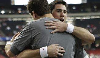 Alabama quarterback AJ McCarron and Georgia quarterback Aaron Murray, right, embrace before the start the Southeastern Conference championship NCAA college football game, Saturday, Dec. 1, 2012, in Atlanta. (AP Photo/Dave Martin)