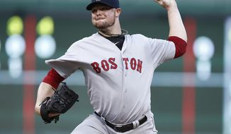 Boston Red Sox starting pitcher Jon Lester throws to the Texas Rangers during the first inning of a baseball game on Saturday, May 10, 2014, in Arlington, Texas. (AP Photo/Jim Cowsert)