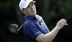Jordan Spieth follows his shot from the seventh tee during the third round of The Players championship golf tournament at TPC Sawgrass, Saturday, May 10, 2014, in Ponte Vedra Beach, Fla. (AP Photo/Gerald Herbert)