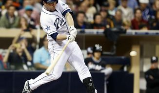 San Diego Padres' Jedd Gyorko connects for a grand slam home run off Miami Marlins starting pitcher Jose Fernandez during the sixth inning of a baseball game Friday, May 9, 2014, in San Diego. It was  Gyorko's second homer of the game and gave him six runs-batted-in. (AP Photo/Lenny Ignelzi)