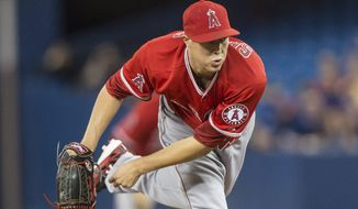 Los Angeles Angels starting pitcher Tyler Skaggs works against the Toronto Blue Jays during the first inning of a baseball game in Toronto on Saturday, May 10, 2014. (AP Photo/The Canadian Press, Chris Young)