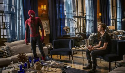 """This image released by Sony Pictures shows Andrew Garfield, left, and Dane DeHaan in the film, """"The Amazing Spider-Man 2."""" (AP Photo/Columbia Pictures - Sony Pictures, Niko Tavernise)"""