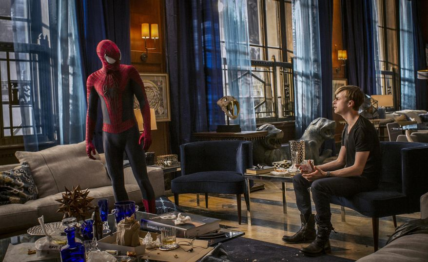 "This image released by Sony Pictures shows Andrew Garfield, left, and Dane DeHaan in the film, ""The Amazing Spider-Man 2."" (AP Photo/Columbia Pictures - Sony Pictures, Niko Tavernise)"