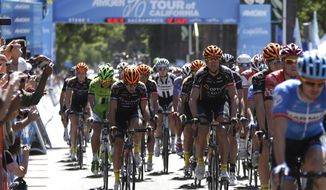 Riders begin the neutral start of Stage I of the Tour of California cycling in Sacramento, Calif., Sunday, May 11, 2014.(AP Photo/Rich Pedroncelli)