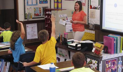 In this Wednesday, Sept. 18, 2013 file photo, Shelly Ellis teaches fourth-grade students in a classroom at Bement Elementary School in Bement, Ill.  (AP Photo/David Mercer) ** FILE **