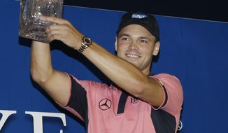 Martin Kaymer of Germany, lifts the The Players championship trophy TPC Sawgrass, Sunday, May 11, 2014 in Ponte Vedra Beach, Fla. (AP Photo/Lynne Sladky)