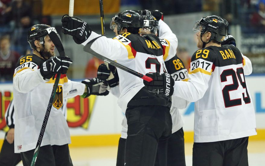 Germany players celebrates their goal during the Group B preliminary round match between Germany and Latvia at the Ice Hockey World Championship in Minsk, Belarus, Sunday, May 11, 2014. (AP Photo/Darko Bandic)