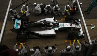 Mercedes driver Lewis Hamilton of Britain gets a pit service during the Spain Formula One Grand Prix at the Barcelona Catalunya racetrack in Montmelo, near Barcelona, Spain, Sunday, May 11, 2014. (AP Photo/Emilio Morenatti)