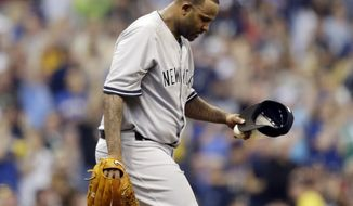 New York Yankees starting pitcher CC Sabathia looks down after giving up a home run to Milwaukee Brewers' Aramis Ramirez in the third inning of a baseball game Saturday, May 10, 2014, in Milwaukee. (AP Photo/Jeffrey Phelps)