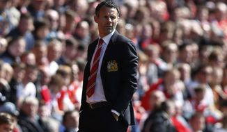 Manchester United's interim manager Ryan Giggs watches his team play against Southampton during their English Premier League soccer match at St Mary's stadium, Southampton, England, Sunday, May 11, 2014. (AP Photo/Sang Tan)