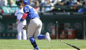 Kansas City Royals' Johnny Giavotella watches his three-run home run take flight in the seventh inning of a baseball game against the Seattle Mariners, Sunday, May 11, 2014 in Seattle. (AP Photo/Ted S. Warren)