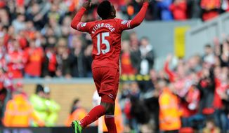 Liverpool's Daniel Sturridge celebrates after he scores the second goal of the game for his side during their English Premier League soccer match against Newcastle United at Anfield in Liverpool, England, Sunday May 11, 2014. (AP Photo/Clint Hughes)