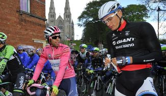 Overall leader Michael Matthews, of Australia, left, and Marcel Kittel, of Germany, wait for the start of the third stage of the Giro d'Italia, Tour of Italy cycling race, from Armagh, Northern Ireland, across the border to Dublin, Ireland, Sunday May 11, 2014.  (AP Photo/Gian Mattia D'Alberto)