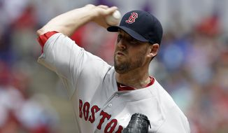 Boston Red Sox starting pitcher John Lackey works against the Texas Rangers in the first inning of a baseball game on Sunday, May 11, 2014, in Arlington, Texas. (AP Photo/Tony Gutierrez)