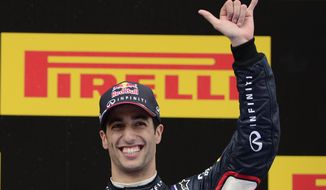 Red Bull driver Daniel Ricciardo of Australia celebrates his third position on the podium at the end of the Spain Formula One Grand Prix at the Barcelona Catalunya racetrack in Montmelo, near Barcelona, Spain, Sunday, May 11, 2014.(AP Photo/Manu Fernandez)