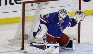 New York Rangers goalie Henrik Lundqvist (30), of Sweden, makes a save during the first period of Game 6 of a second-round NHL playoff hockey series against the Pittsburgh Penguins, Sunday, May 11, 2014, in New York. (AP Photo/Seth Wenig)