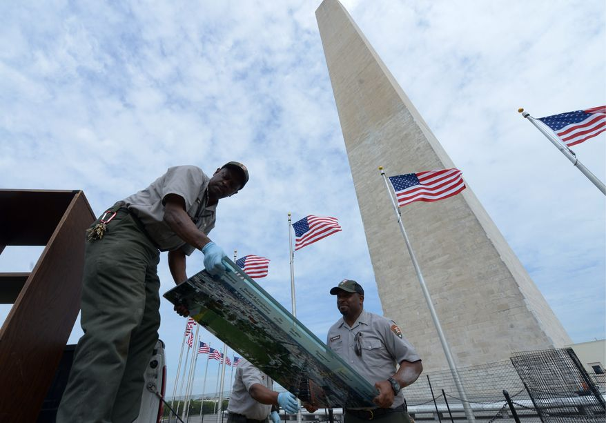 National Park Service workers remove old items from the Washington Monument in preparation of the monument reopening to the public on Monday. The Washington Monument has been closed since an August 2011 earthquake. (Photographs by Khalid Naji-Allah/Special to The Washington Times)