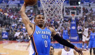 Oklahoma City Thunder guard Russell Westbrook goes up for a dunk in the first half of Game 4 of the Western Conference semifinal NBA basketball playoff series against the Los Angeles Clippers, Sunday, May 11, 2014, in Los Angeles. (AP Photo/Mark J. Terrill)