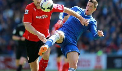 Cardiff City's Ben Turner, left, battles for the ball with Chelsea's Fernando Torres during the English Premier League soccer match at the Cardiff City Stadium, Cardiff, Sunday May 11, 2014. (AP Photo/PA, David Davies) UNITED KINGDOM OUT  NO SALES  NO ARCHIVE