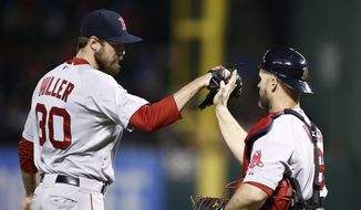 Boston Red Sox relief pitcher Andrew Miller (30) and catcher David Ross (3) congratulate each other following their team's 8-3 win over the Texas Rangers, Saturday, May 10, 2014, in Arlington, Texas. (AP Photo/Jim Cowsert)