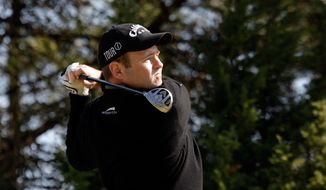 **FILE** Alastair Forsyth, from Scotland tees off during the first round of the Estoril Open de Portugal Thursday, April 2 2009, at the Oitavos Dunes golf course in Cascais, outside Lisbon.  (AP Photo/Armando Franca)