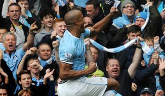 Manchester City's Vincent Kompany celebrates with fans after scoring against West Ham during the English Premier League soccer match between Manchester City and West Ham United at the Etihad Stadium,  Manchester, England, Sunday, May 11, 2014. (AP Photo/Rui Vieira)