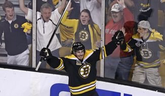 Boston Bruins left wing Loui Eriksson (21) celebrates his goal against Montreal Canadiens goalie Carey Price during the third period of Game 5 in the second-round of the Stanley Cup hockey playoff series in Boston, Saturday, May 10, 2014. (AP Photo/Charles Krupa)