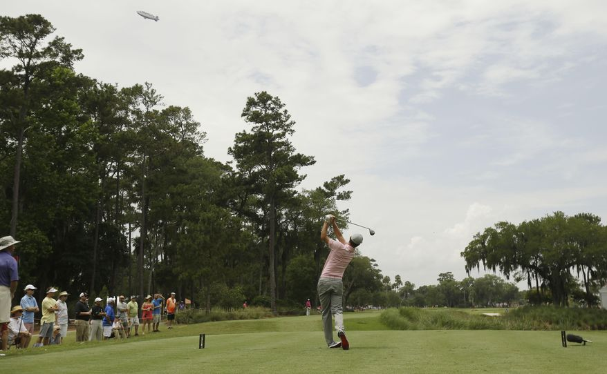 Justin Rose of England, hits from the ninth tee during the final round of The Players championship golf tournament at TPC Sawgrass, Sunday, May 11, 2014 in Ponte Vedra Beach, Fla. (AP Photo/Gerald Herbert)