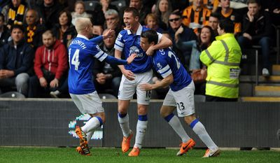 Everton's James McCarthy, centre, celebrates with teammates Steven Naismith, left, and Seamus Coleman after scoring his side's first goal during their English Premier League soccer match against Hull City at KC Stadium, Hull, England, Sunday, May 11, 2014. (AP Photo/Anna Gowthorpe, PA Wire)    UNITED KINGDOM OUT   -   NO SALES    -    NO ARCHIVES