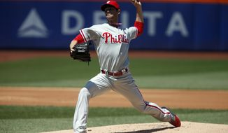 Philadelphia Phillies' Cole Hamels delivers a pitch during the first inning of a baseball game against the New York Mets, Sunday, May 11, 2014, in New York. (AP Photo/Jason DeCrow)